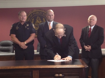 Macon leaders sign Juvenile Court agreement (l-r Macon Police Chief Mike Burns, Bibb County District Attorney Greg Winters, Bibb County Sheriff Jerry Modena, Thomas Matthews, Chief Judge Juvenile Court of Bibb County) photo Josephine Bennett