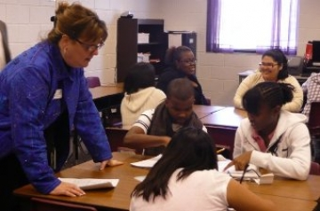 Kathy Cox, the state schools superintendent, visits with high school students last year.  (Photo from Facebook)