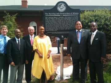 Board members of the Georgia Historical Society pose with a new marker at the site where Gen. William T. Sherman ordered Confederate military resources burned -- about 40 percent of the city of Atlanta.