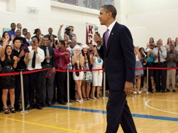 President Barack Obama greets students from Kalamazoo Central High School's graduating class, during a surprise appearance in a gym at Western Michigan University in Kalamazoo, Mich., June 7, 2010. The President later delivered the school's commencement address after they won the 2010  Race to the Top High School Commencement Challenge. (Official White House Photo by Pete Souza.)