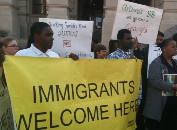 Groups say the immigration bill encourages racial profiling. Groups say they will sue if the bill passes. (Photo by Susanna Capelouto)