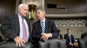 Sen. John McCain, R-Ariz., (left) and Sen. Lindsey Graham, R-S.C., confer at the start of a Senate Armed Services Committee hearing on the appointments of military leaders on Feb. 14. McCain and Graham have been among the Republicans pushing the Obama administration for answers about the Benghazi attack.