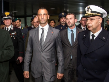 Italian marines Massimilian Latorre, left, and Salvatore Girone, who are at the center of a diplomatic row between India and Italy, return to Rome on Feb. 23. The two men have been charged in India with killing two fishermen, whom they mistook for pirates. India is demanding their return.