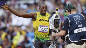 Jamaica's Usain Bolt gestures to a camera after running in an Olympic 100-meter semifinal. There's no telling when Americans might have seen his actions, as NBC tape-delays top events. Online, fans are finding ways around the network's strategy.