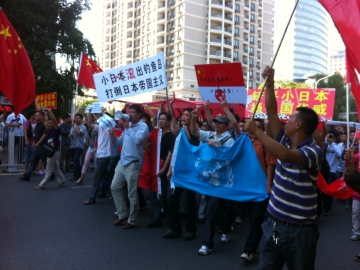 Protesters march outside the Japanese Embassy in Beijing Saturday. Tension escalated, sometimes to violence, in cities across China over Japan's purchase of disputed islands.