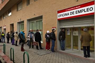 People queue up at a government job center in Madrid this month. The unemployment rate in Spain now tops 25 percent, but many government workers still enjoy job security and higher wages than their private sector counterparts.