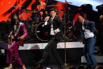 Robin Thicke, center, performs with Verdine White, left, and T.I. at The Grammy Nominations Concert Live!! in Los Angeles in December. Thicke is nominated for Outstanding Male Artist at the NAACP Image Awards this year.