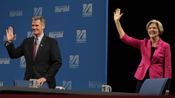 Republican Sen. Scott Brown and Democratic challenger Elizabeth Warren prepare to spar at a debate earlier this month in Lowell, Mass.