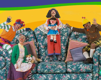 Kids Show With Girl Clown And Her Doll