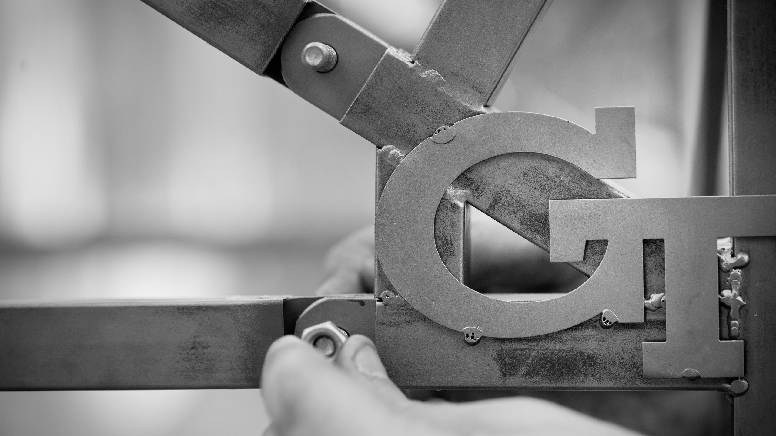 Image of Georgia Tech GT logo being designed with metalwork