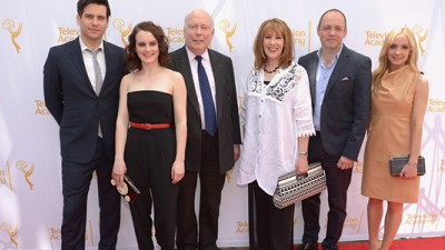 Downton Abbey Cast members and producers Julian Fellowes and Gareth Naeme mug for cameras before their webast.