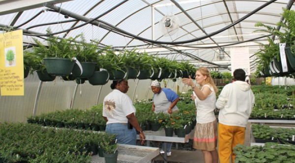 Colquitt County High School Teacher Adrienne Smith helps customers at a FFA Plant Sale.  Photo: www.theblackandgold.org