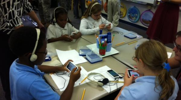 Students doing high-tech work at Taylor's Creek Middle School