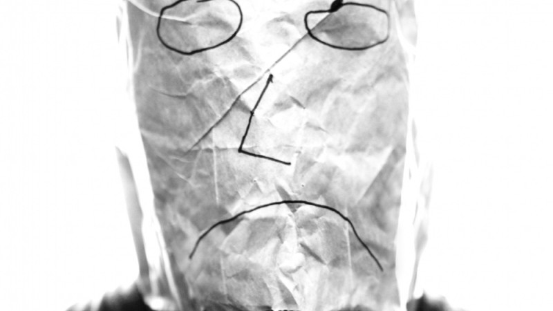 (Photo Courtesy of <a href=http://upload.wikimedia.org/wikipedia/commons/0/0d/Gray_paper_bag_with_sad_smiley_over_head.jpg>Saibo
