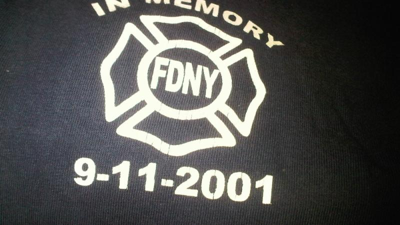 Sleeve of a t-shirt given to me by the NY Firefighters. I wear it every year on the anniversary of 9/11.