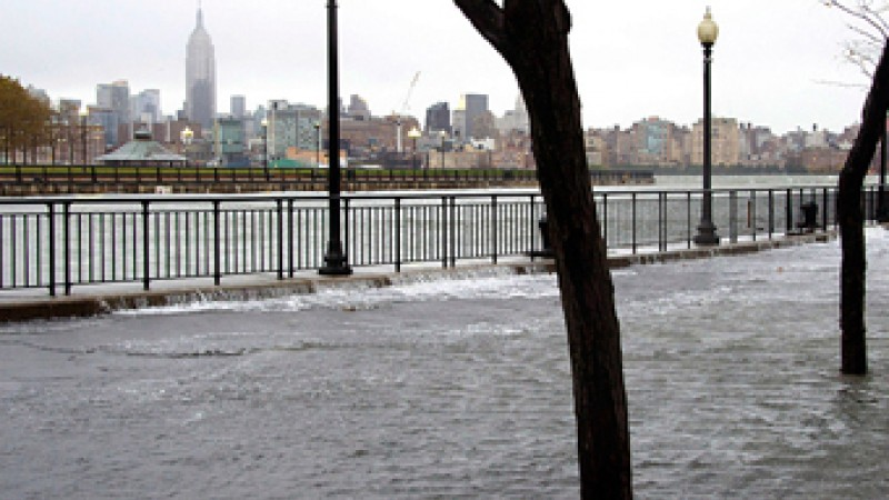 The Hudson River swells and rises over the banks of the Hoboken, NJ. Photo courtesy Charles Sykes/AP