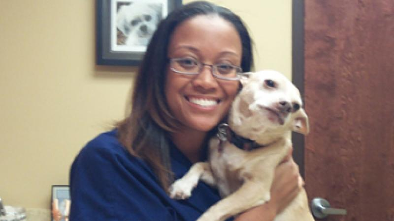 Dr. Johnson nuzzles Petey, her beloved chihuahua rescue and office greeter!