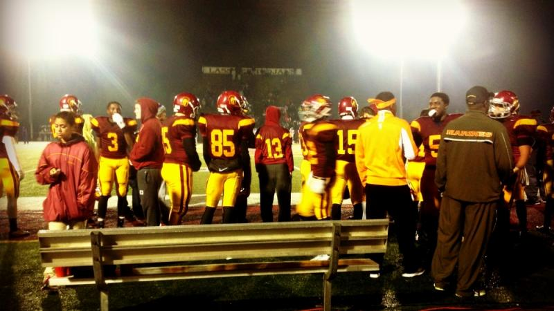 The Lassiter Trojans fell to the Peachtree Ridge Lions in a rainy first round playoff meeting.