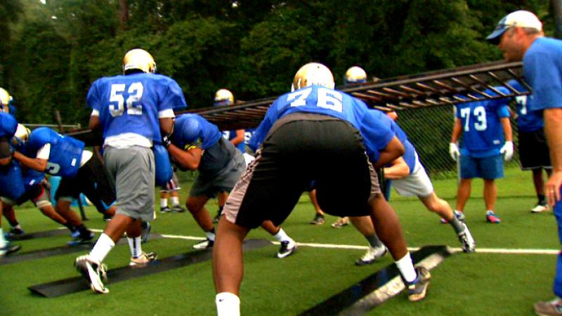 The McEachern Indians spend quality time on the field in preparation for Saturday's contest against the Brookwood Broncos.