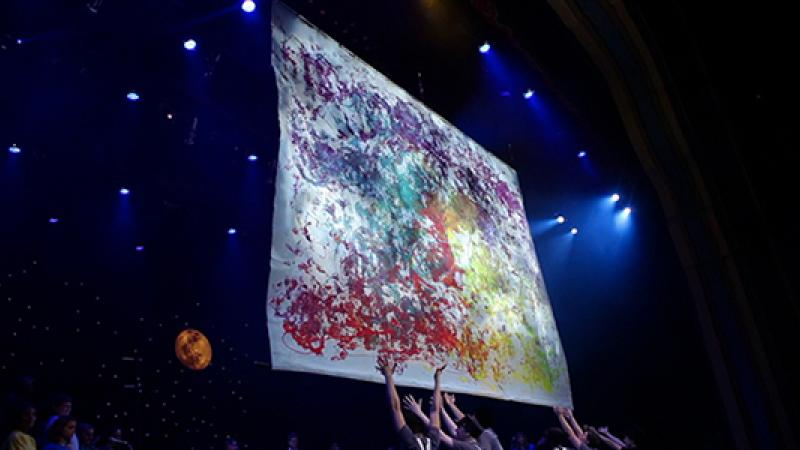 During the Live Art concert, students create artwork while onstate.