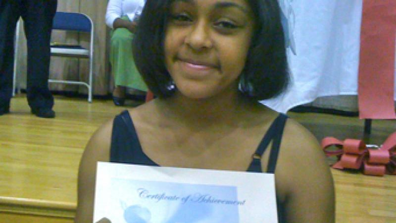 My goddaughter Machaela Goodbee shows off her honor roll certificate. Way to go Machaela!