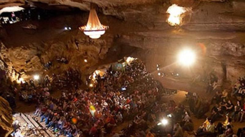 Crowd gathered for a concert inside a cave in Underground Bluegrass/ pbs.org/arts