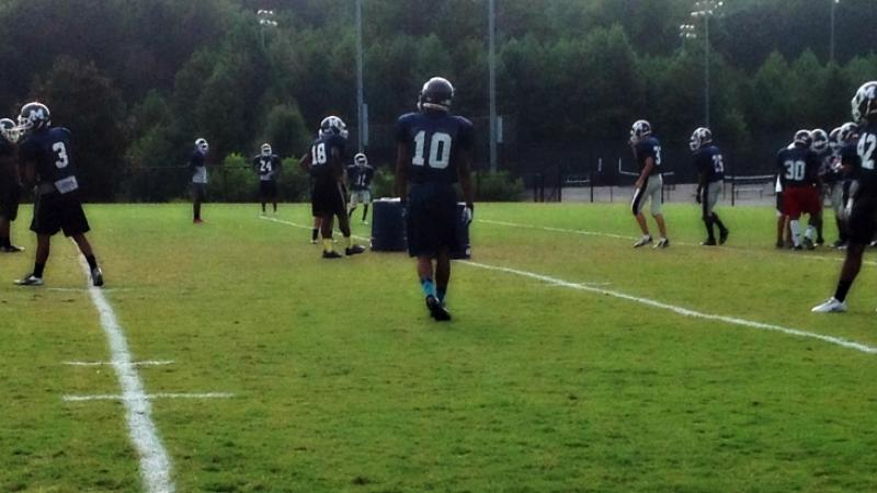 Ty practices with the linebackers Wednesday before his team meets their rival McEachern Indians at Northcutt Stadium