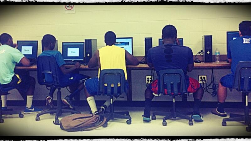 Chattahoochee High School football players take the baseline test on computers