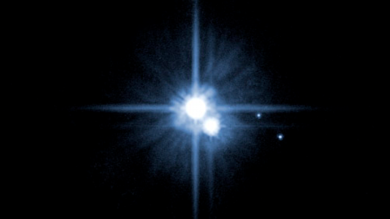 2005, then-new moons Nix and Hydra are the dots on the right. Credit: NASA, ESA, H. Weaver (JHU/APL), A. Stern (SwRI), HST Pluto