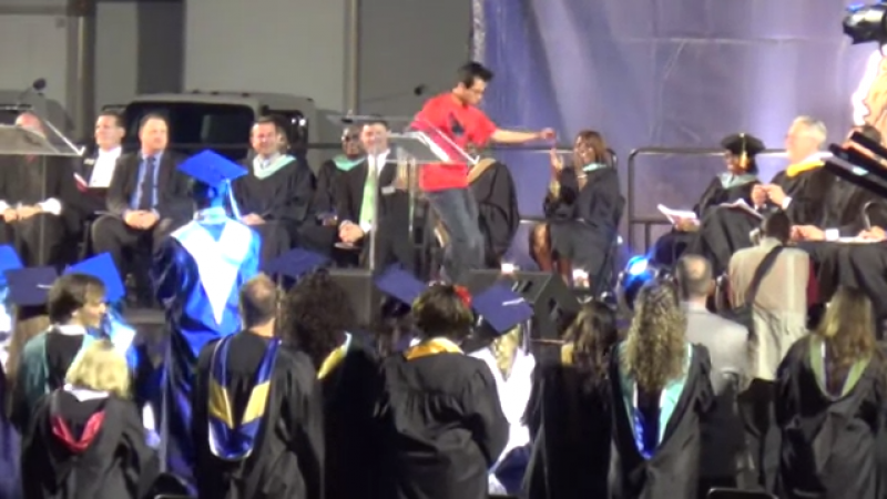 Parker Pitisci dances across his graduation stage.