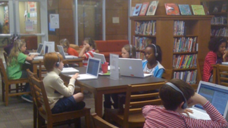 Students at 4/5 Academy measure their academic progress using programs on Macbooks.