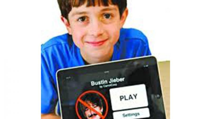 Thomas Suarez created the Bustin Jieber app for iPhones and iPads to learn how to develop apps. Photo from ixwebhosting.mobi.