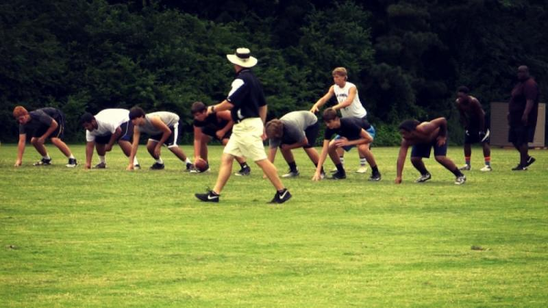 New Carrollton Head Coach Ed Dudley directs the action at a summer practice.