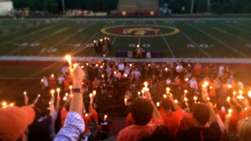 A candlelit ceremony quieted thousands present for the memorial of Philip Lutzenkirchen, who passed away on June 29, 2014.