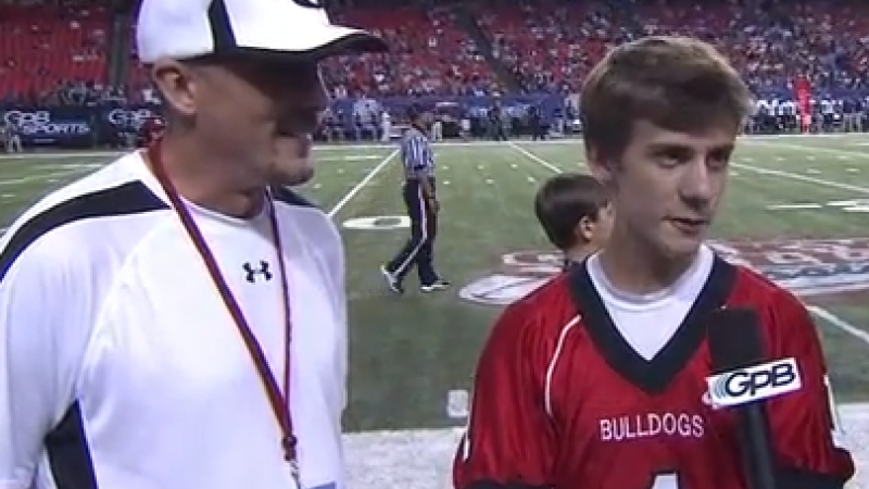 GPB Sports interviews Cooper as North Gwinnett takes on Camden County at the Georgia Dome on August, 2013.