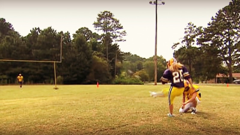 Taylor Tidaback attempts a field goal during football practice.
